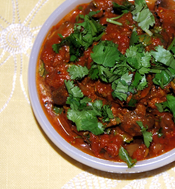 Mushroom Achari is made by sauteing meaty mushrooms in pickling spices. An Indian vegan recipe.