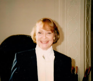 Daphne Neville playing a receptionist