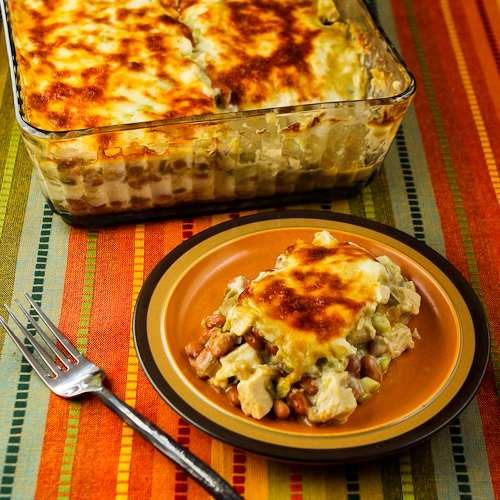 Layered Mexican Casserole with Chicken, Green Chiles, Pinto Beans, and Cheese