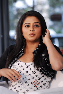 Priyamani Latest High Resolution Crossed Legs Pictures in White Jeans at Sakshi TV Interview