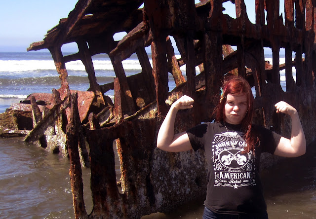 Amanda Zito in front of the Peter Iredale Shipwreck on the Oregon Coast in Fort Stevens State Park