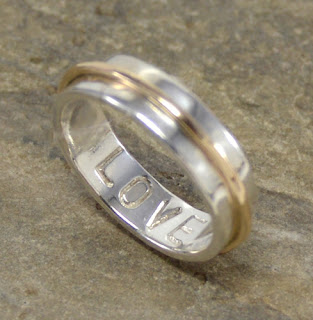 http://brackendesigns.com/product/sterling-silver-and-gold-fill-satellite-ring-saturn-inspired-size-5%C2%BC