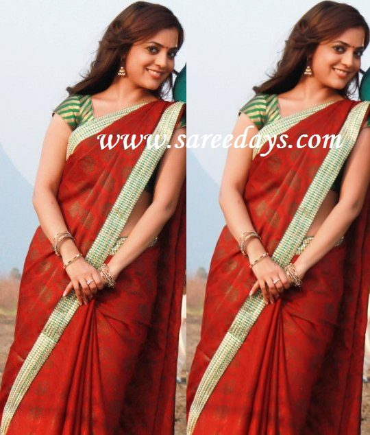 Latest saree designs nisha agarwal in red printed designer saree checkout actress nisha agarwal in red printed designer saree with green border and paired with green silk short sleeves blouse thecheapjerseys Images