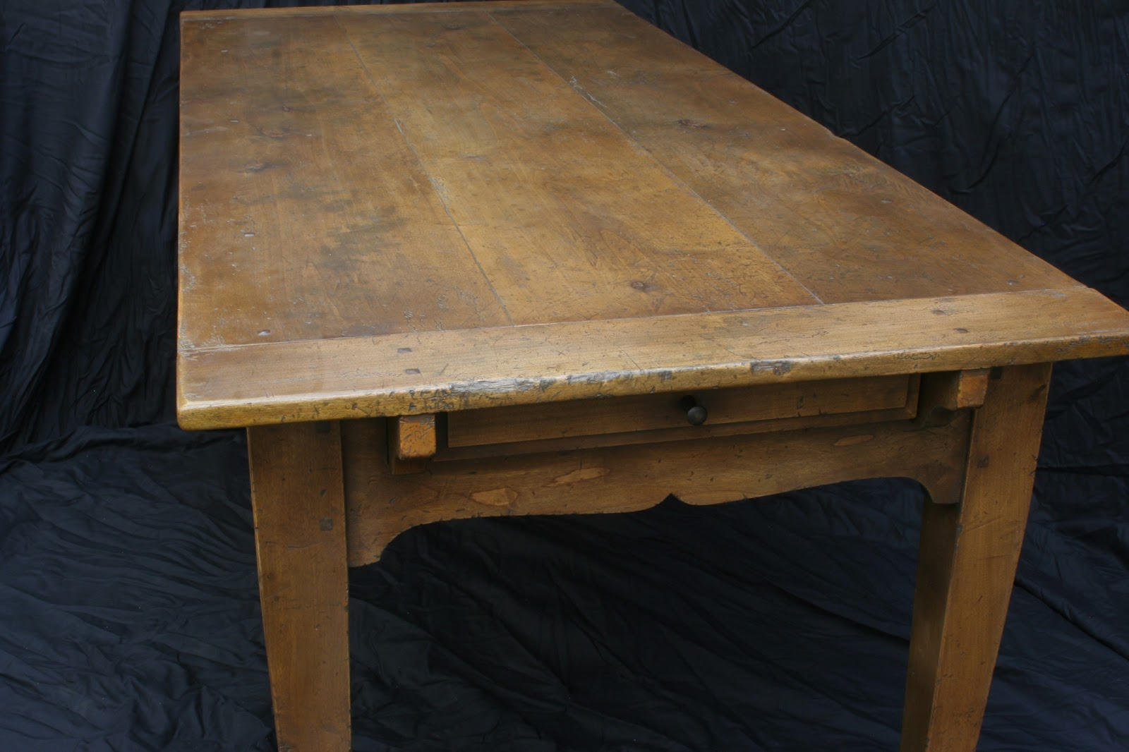 newly built handmade farmhouse table with antique distressed finish and self storing leaves