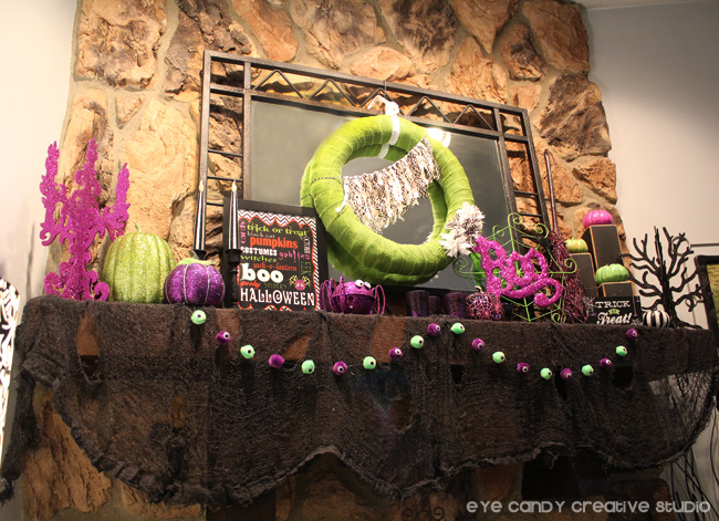 full mantel view, decorated halloween mantel, green & purple halloween
