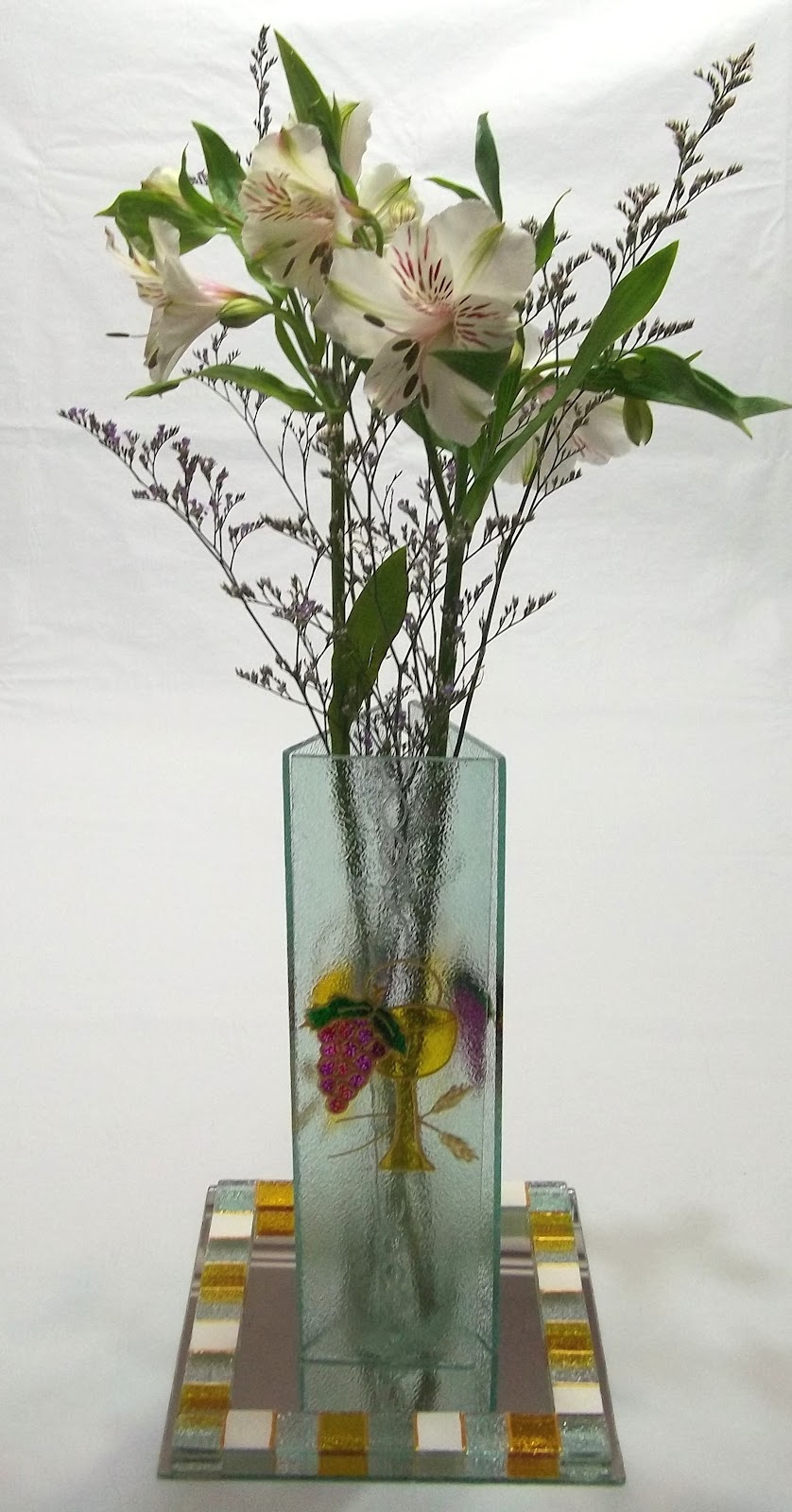 Entrevidrios centros de mesa floreros con base de espejo for Centro de mesa de cristal