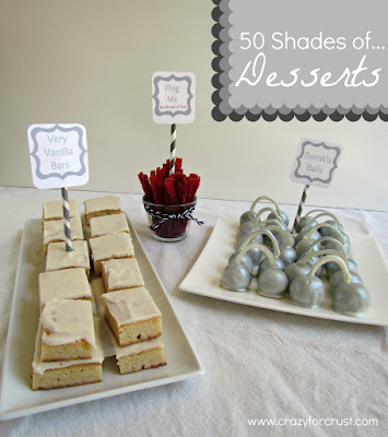 Very vanilla bars on a white tray with silver cake balls and red licorice.