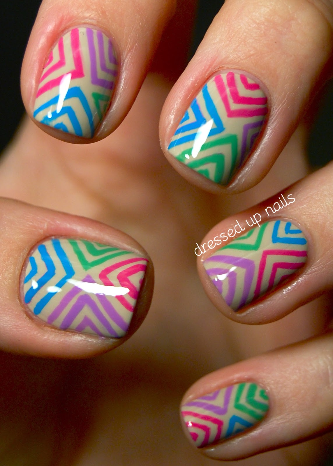 Dressed Up Nails: Colorful offset chevron nail art on a nude base