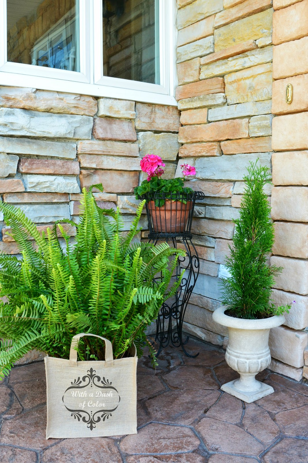 With A Dash Of Color Burlap Bag Planter: plants next to front door
