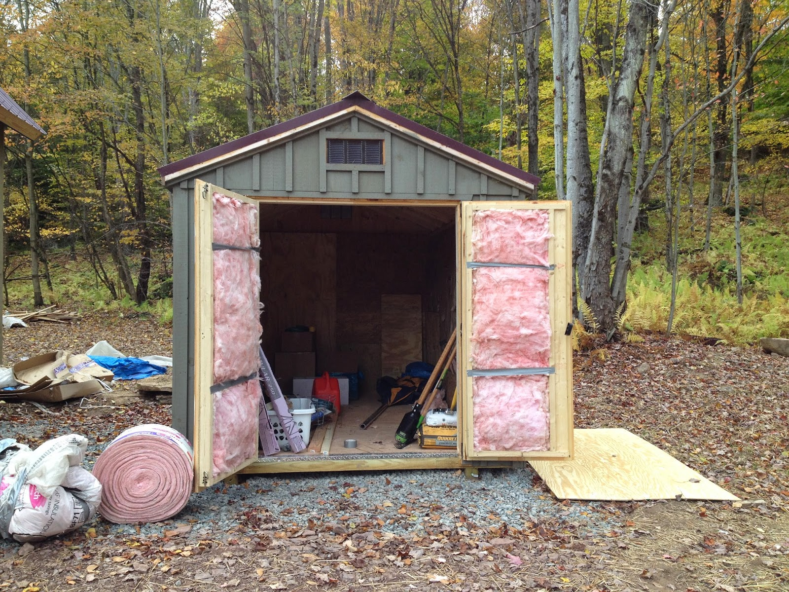 We use leftover insulation scraps to give the Amishmade shed some