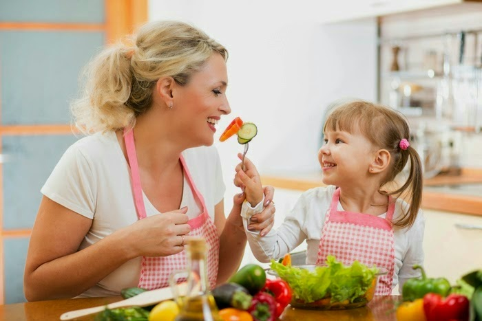 mom and daughter eating healthy foods
