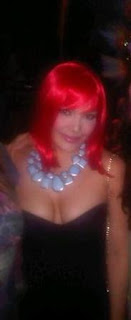 KC Concepcion red wig party