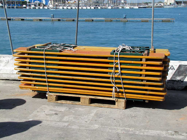 Stack of folded benches, Porto Mediceo, Livorno