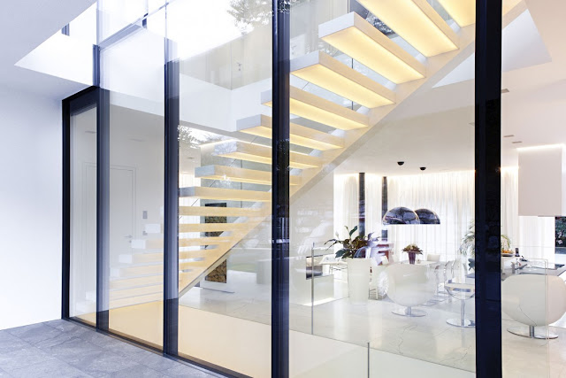 White modern staircase by the glass wall