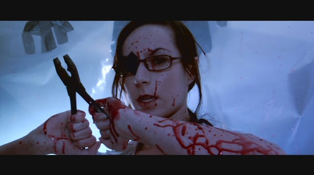 A very awesome torture scene in Dead Hooker in a Trunk