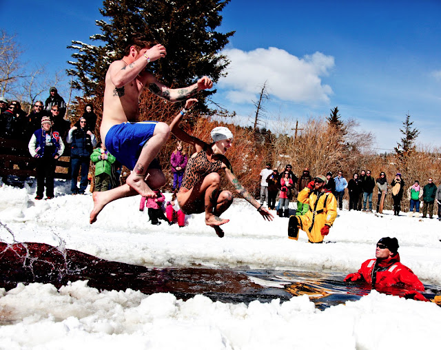 Two polar plunge participants about to hit some very cold water at the Frozen Dead Guy Days in Nederland, Colorado.
