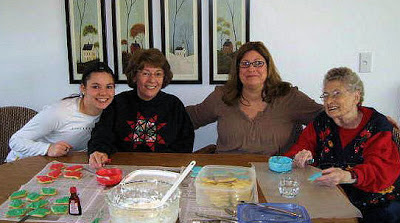 My daughter, mother, me, and my grandmother decorating cookies.