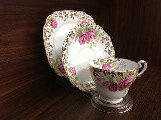 Three peice cup, sauce and plate bone china, white with pink floral and gold motive $25