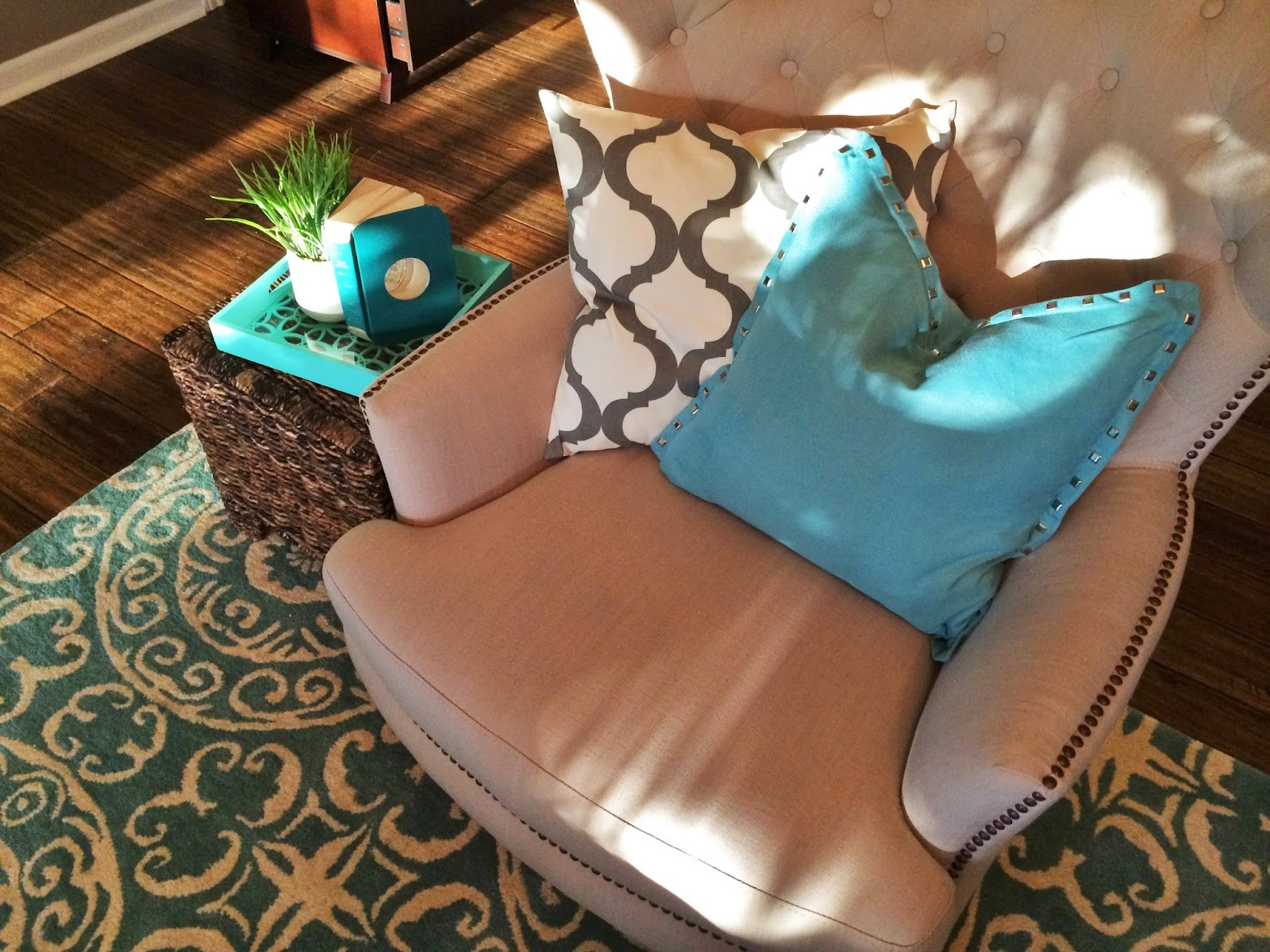 Turquoise and brown accent chair - With This Client We Started With A Very Neutral Space Dark Hardwood Floors Grayish Brown Leather Sofa Light Tan Accent Chair And Gray Walls