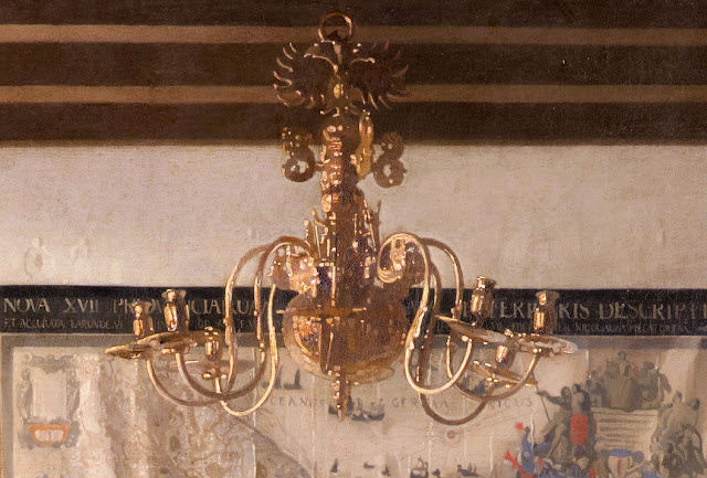 Close-up view of chandelier and the double-headed eagle at the top—symbolic of the Habsburg Empire that controlled the Burgundy region (Southern Netherlands & Belgium). Photo: WikiMedia.org.