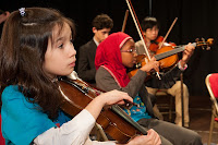 The young musicians of the Sullivan Orchestra perform during In Harmony Lambeth's winter concert. (Photo: Reynaldo Trombetta / In Harmony Sistema England) — at Southbank Centre.