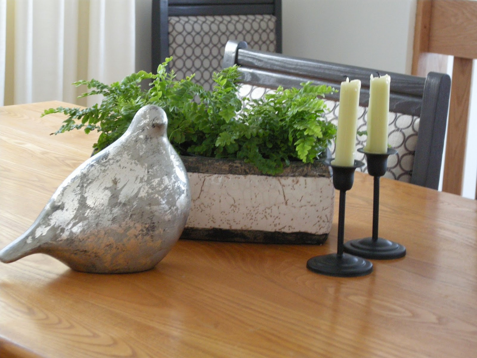 silver leaf bird, candles, boston ferns, trough planter, dining table, centrepiece