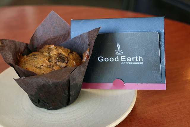 Pumpkin Spice Muffin on a plate with a Good Earth giftcard on top.