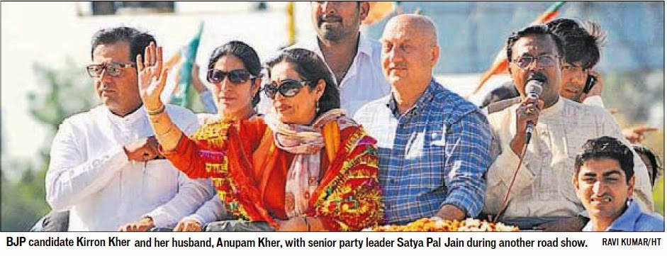 BJP candidate Kirron Kher and her husband, Anupam Kher, with senior party leader Satya Pal Jain during another road show. Ravi Kumar/HT