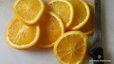 ... , slice the orangeinto thin round slices, keeping the peel on
