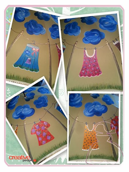 Detalles de la decoración del paraguas pintado a mano modelo ropita tendida, realizado por Sylvia Lopez Morant.