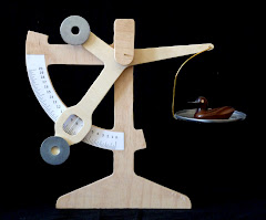 Homemade weighing scale with wooden duck
