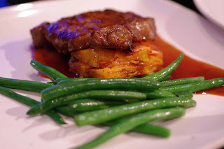 Beef sirloin with sweet potato stack and green beans image