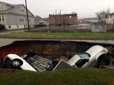 Ground (Sinkhole) Opens In Chicago, Swallowing 3 Cars