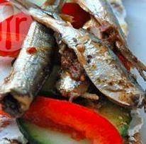 Receita para aprender como fazer sardinhas em conserva de alta qualidade. Foto do prato pronto para consumo.