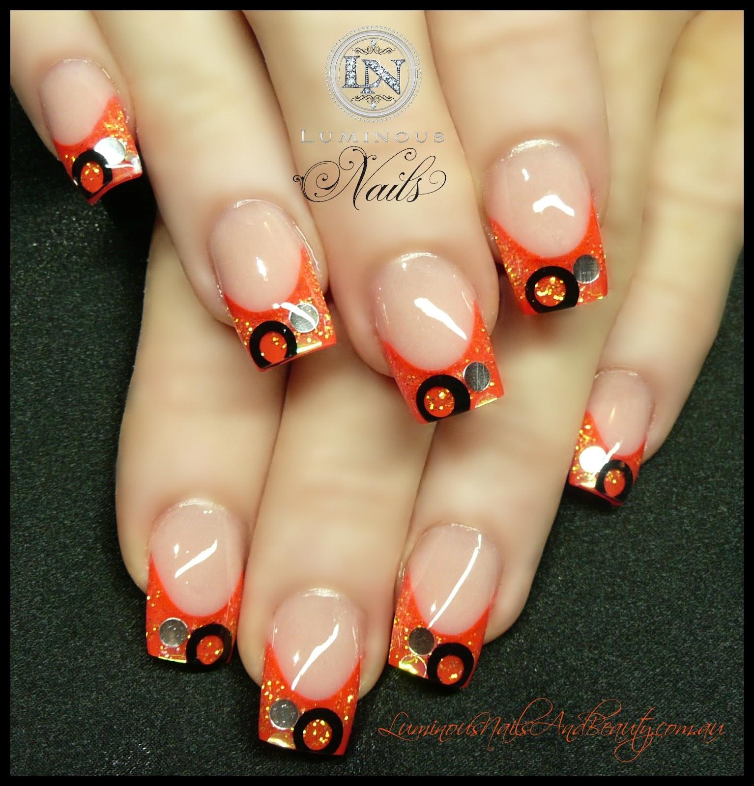 bright orange acrylic nails