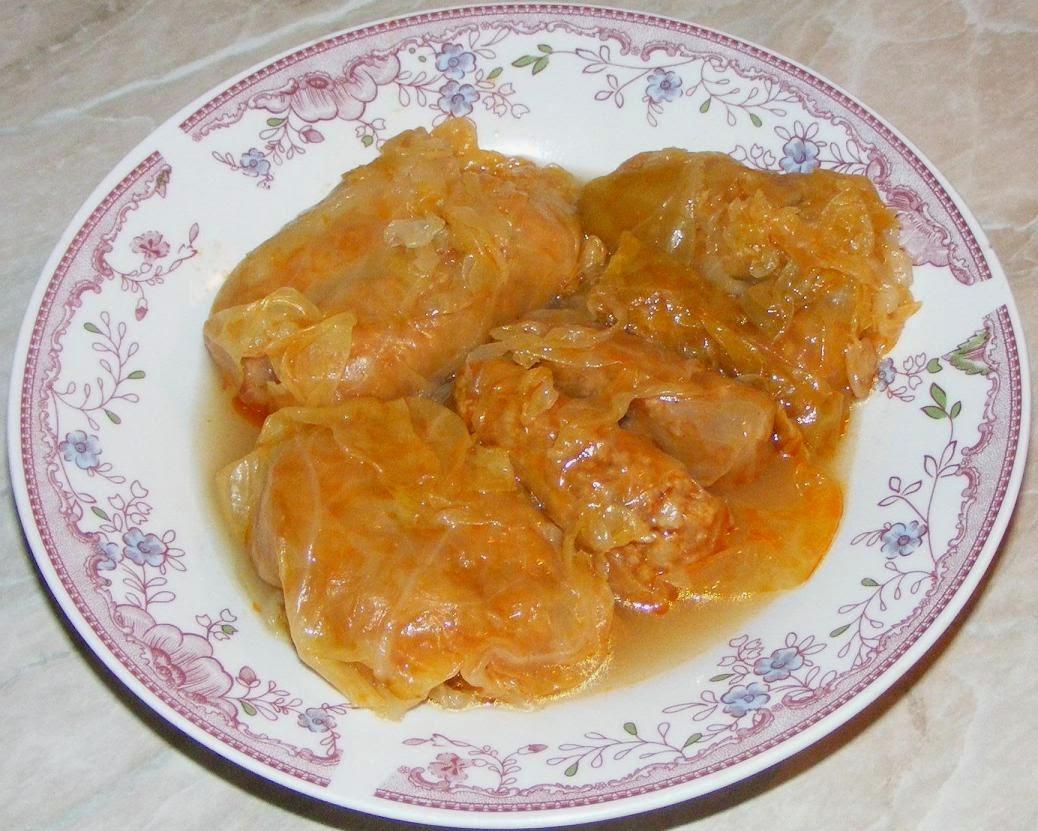 retete si preparate culinare din mancare pentru masa de craciun si anul nou sarmale de porc cu foi de varza murata in cuib