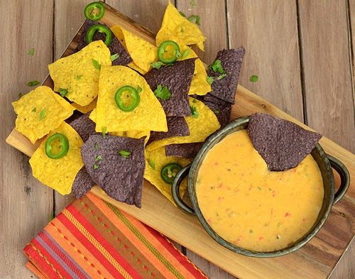 Pulled pork queso for nachos, BBQ queso, tailgate food, party food, best queso recipe