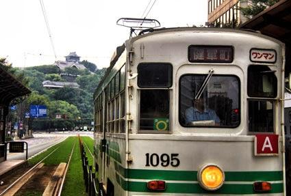 Kumamoto Tram, with Kumamoto Castle, Kyushu, Japan
