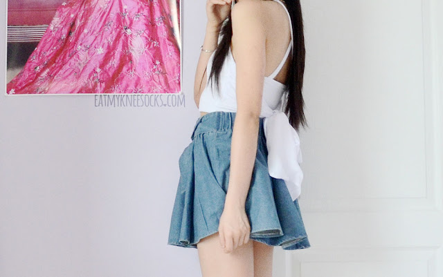 A cute ulzzang outfit, with the Tokyo Fashion denim bow skater skirt from Yumart and a tie-back crop top.