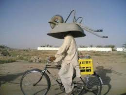 funniest picture: cart on the head of the cyclists