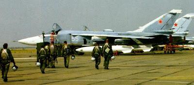 На заднем плане - бомбардировщики Су 24М