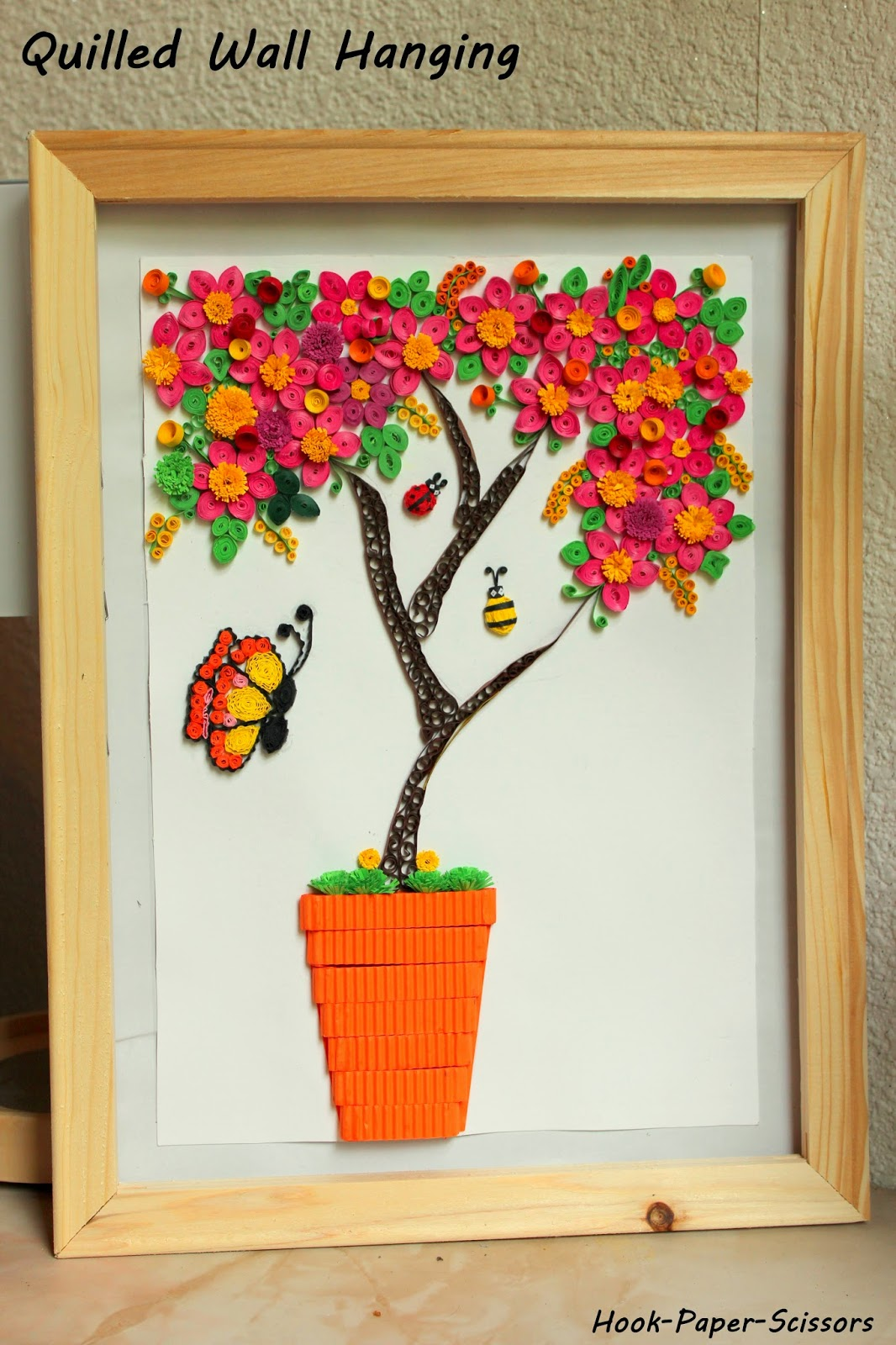 hook paper scissors quilled wall hanging