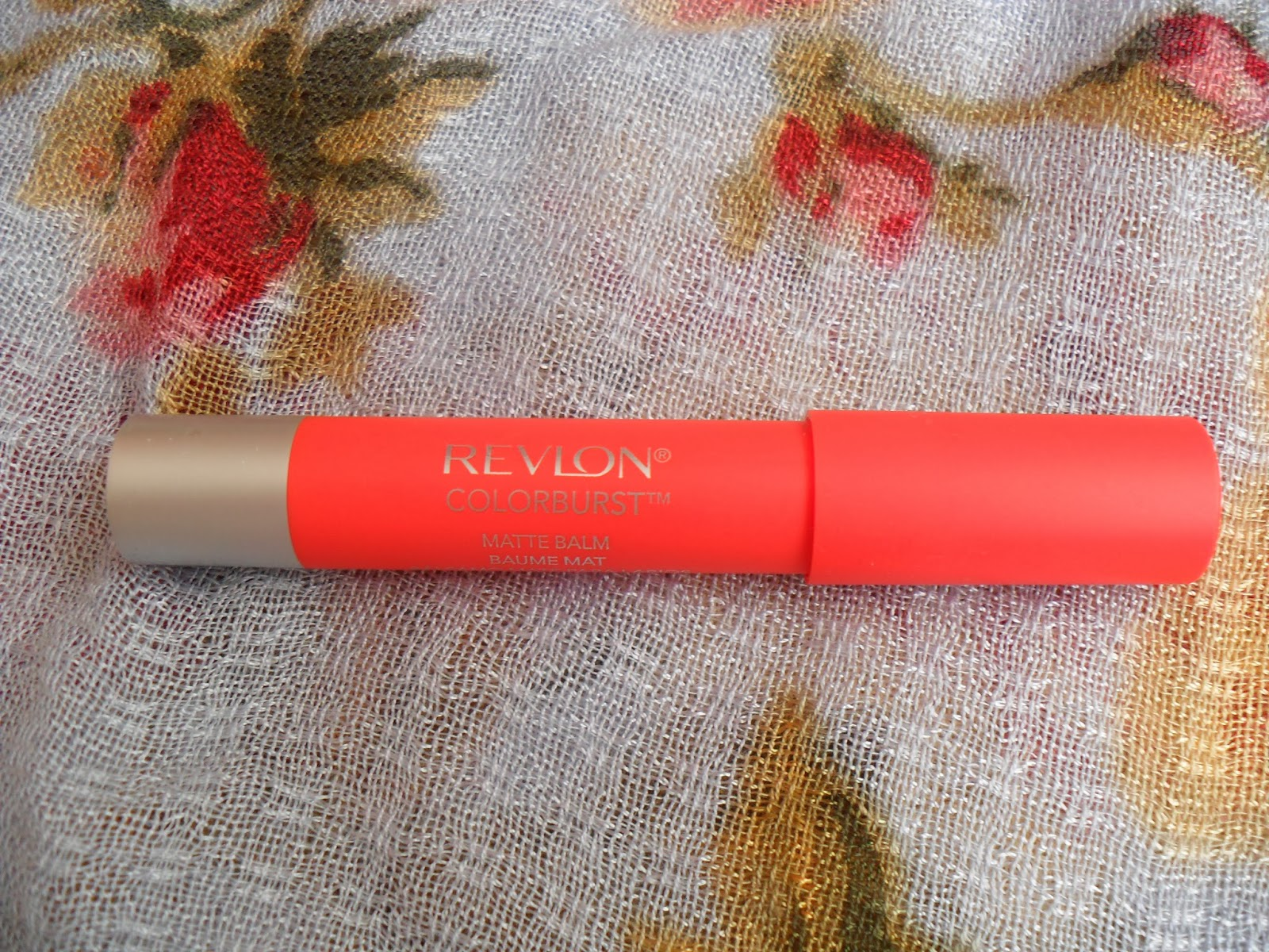 A pictures of a Revlon lip product in Audacious