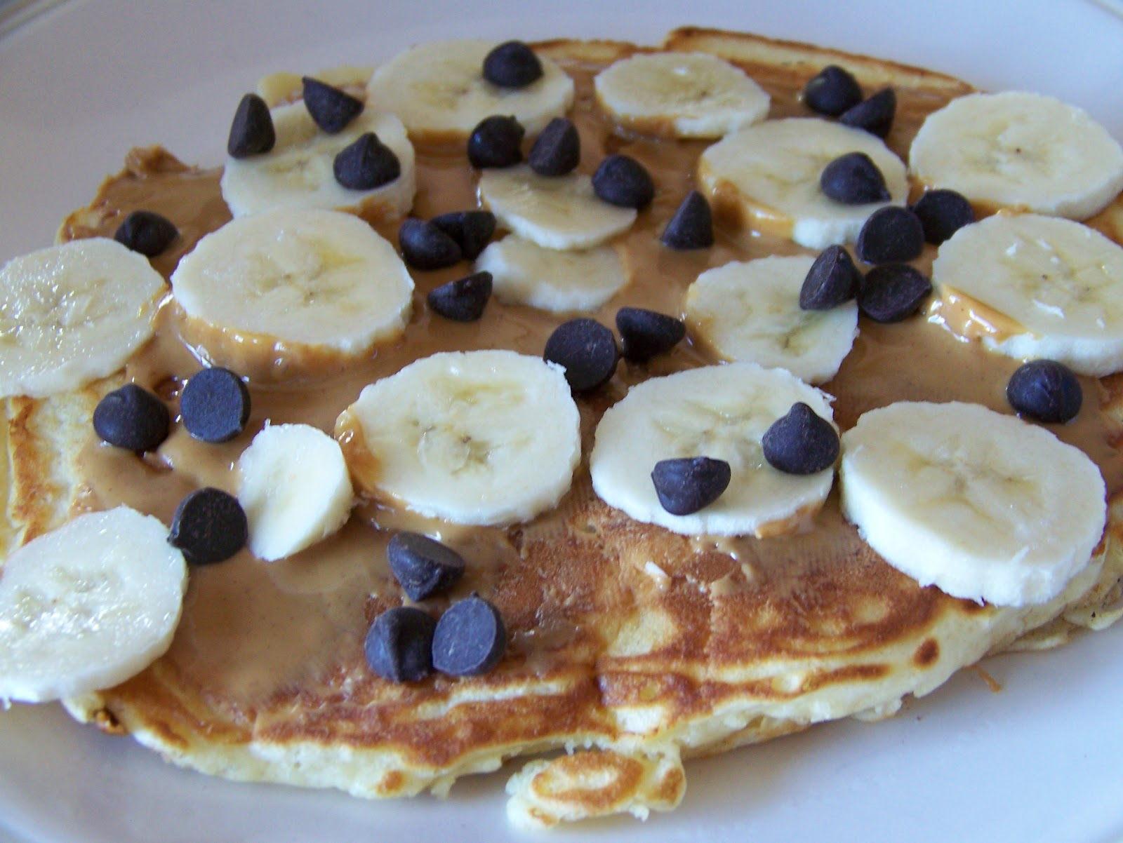 is simple: pancake, peanut butter, banana slices, chocolate ...
