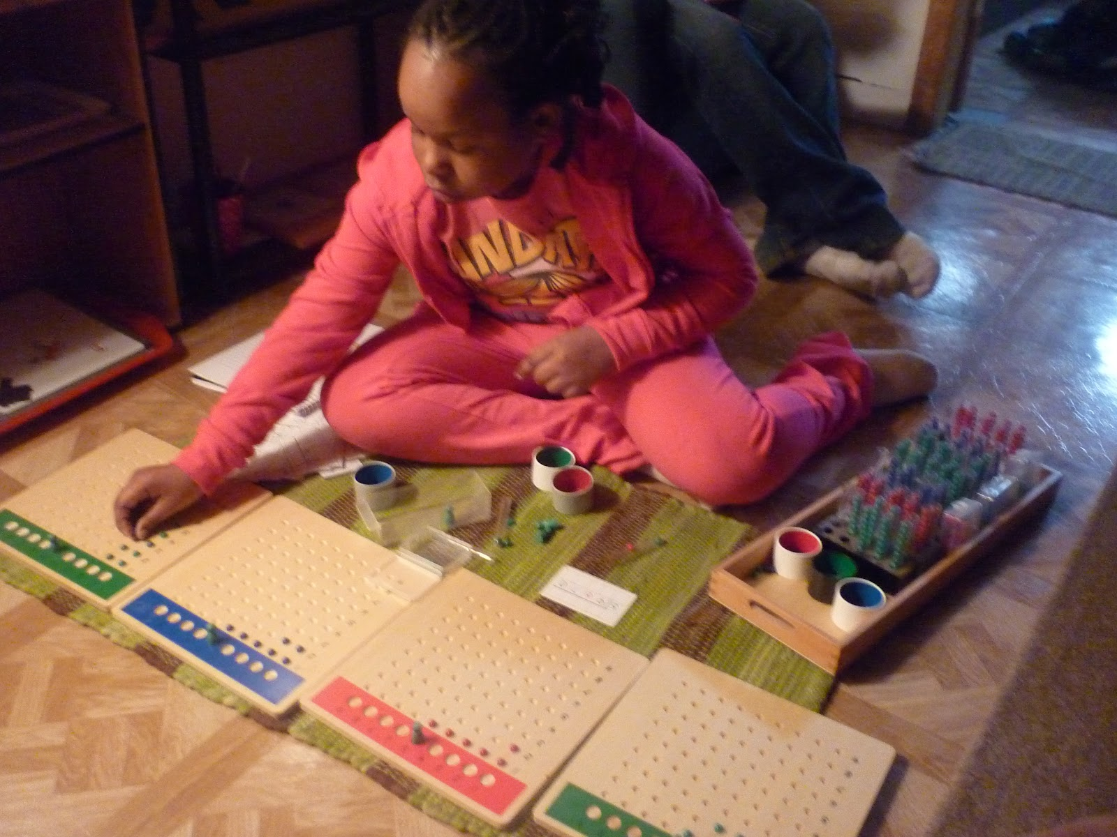 Long Division Boards with Racks and Tubes (Photo from We Don't Need No Education)