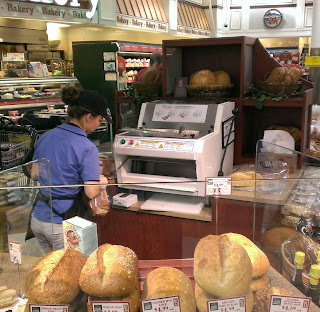 automatic bread slicer at a grocery store