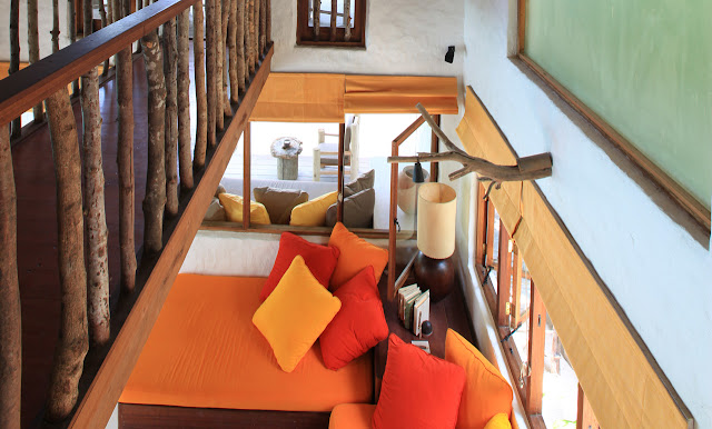 Photo of pillows on the couch as seen from the upper level inside of one of the residences