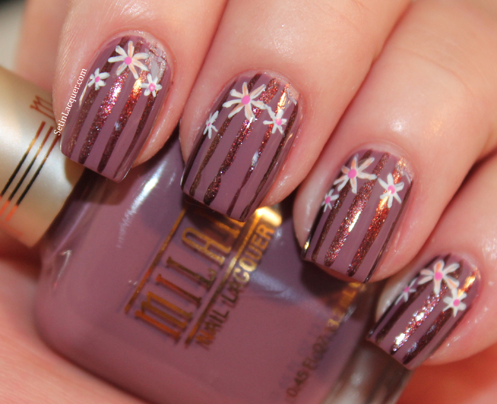 Striped nail art with floral accents using Milani