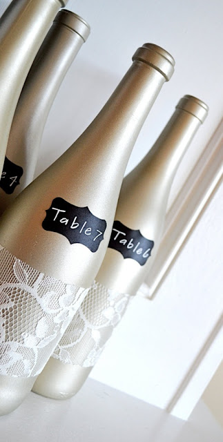 Wine bottles at a wedding, vineyard wedding, elegant wedding, gold wedding, lace wedding, wine-themed wedding, decorated wine bottles,  Catholic wedding, Catholic wedding planning, Catholic wedding plan, Catholic bride