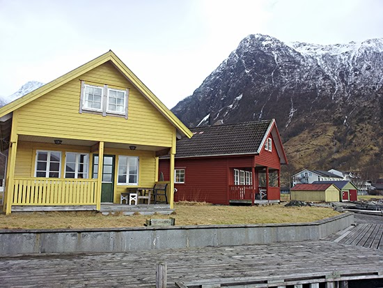 photo of village houses by a mountain
